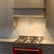 Ferrari Red Range and Roman Backsplash Define This Space